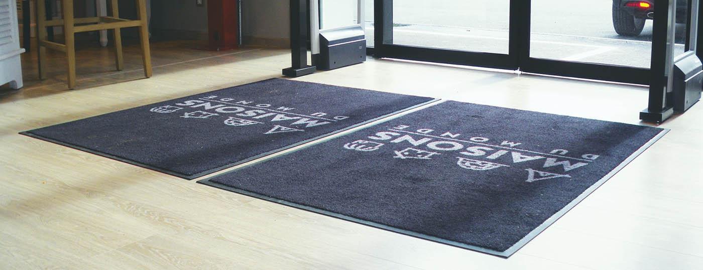 Photo d'un tapis d'accueil installé par 2Dmat dans un magasin de Maison du Monde à Paris
