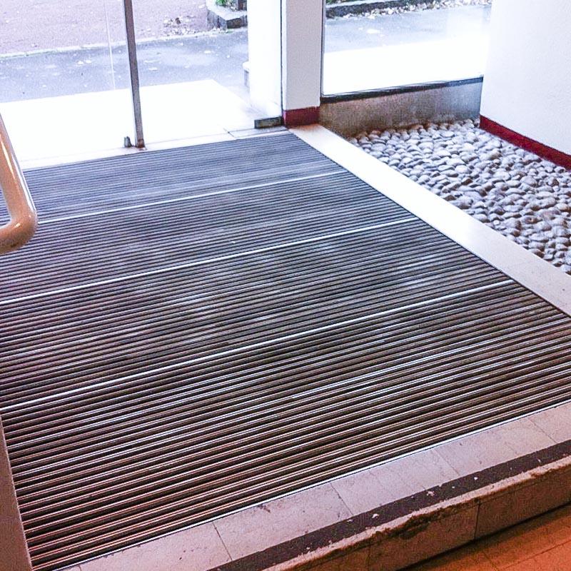 2Dmat expert en tapis d'accueil et tapis d'entrée- Pour tout rype d'mmeuble, bureaux, centre commercial, lieux publics